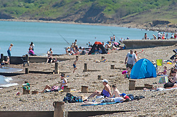 ©Licensed to London News Pictures 20/05/2020  <br /> Minster on sea, UK. A busy beach. People enjoying their lockdown freedom with a day by the sea at Minster-on-sea on the Isle of Sheppey in Kent. Today is expected to be the hottest day of the year with temperatures in the South East of the UK to hit around 29C. Photo credit:Grant Falvey/LNP