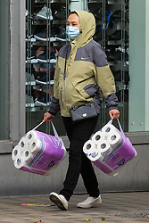 © Licensed to London News Pictures. 25/09/2020. London, UK. A woman carrying toilet rolls in London, as supermarkets start to run out of essential items, amidst a possible second lockdown due to a rise in COVID-19 cases. A number of supermarkets are restricting shoppers from bulk-buying products such as flour, pasta, toilet rolls and anti-bacterial wipes. Photo credit: Dinendra Haria/LNP