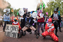 A troupe of clowns joins fellow climate activists from Extinction Rebellion at a 'Carnival of Corruption' protest against the government's facilitation and funding of the fossil fuel industry on 3 September 2020 in London, United Kingdom. Extinction Rebellion activists are attending a series of September Rebellion protests around the UK to call on politicians to back the Climate and Ecological Emergency Bill (CEE Bill) which requires, among other measures, a serious plan to deal with the UK's share of emissions and to halt critical rises in global temperatures and for ordinary people to be involved in future environmental planning by means of a Citizens' Assembly.