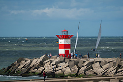 Lighthouse on the pier during the final. The Final Day of the DELA NK Beach volleyball for men and women will be played in The Hague Beach Stadium on the beach of Scheveningen on 23 July 2020 in Zaandam.