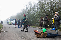 Denham, UK. 6 February, 2020. Environmental activists from Save the Colne Valley, Stop HS2 and Extinction Rebellion move at a snail's pace along a road in order to block a security vehicle and truck delivering fencing and other supplies to be used for works associated with the HS2 high-speed rail link close to the river Colne at Denham Ford. Works planned in the immediate vicinity include the felling of trees and the construction of a Bailey bridge, compounds and fencing, some of which in a wetland nature reserve forming part of a Site of Metropolitan Importance for Nature Conservation (SMI).