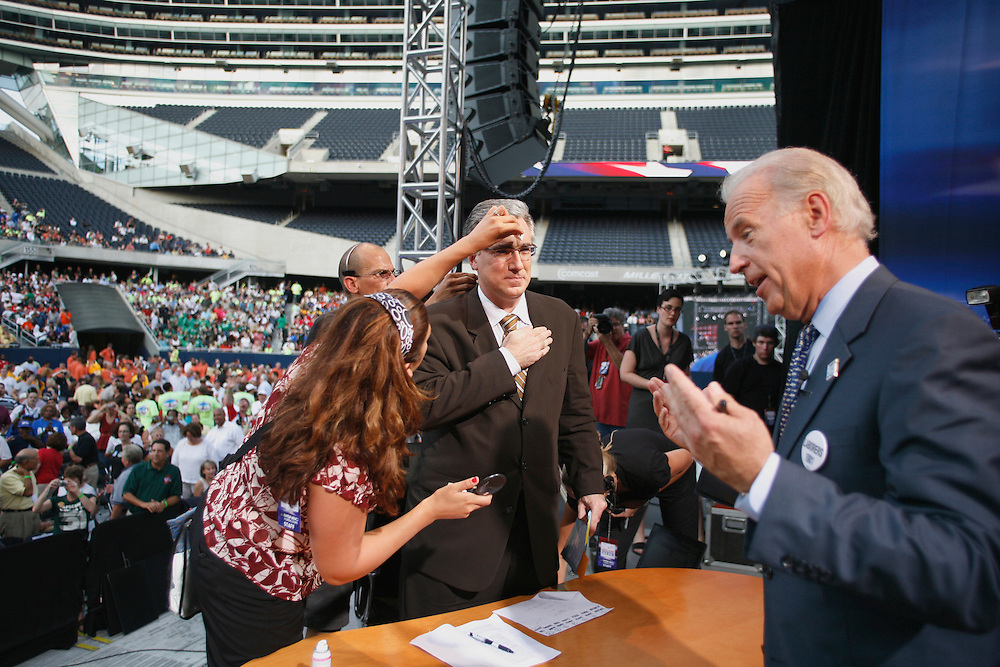 Senator Joe Biden (D) of Delaware, right, talks to moderator Keith Olbermann of MSNBC during a commercial break at an AFL-CIO Working Families Presidential Candidates Forum at Soldier Field in Chicago Tuesday evening.