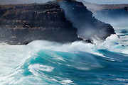 Unusually powerful and large waves wash against the sea cliffs of Espanola Island, Galapagos Archipelago - Ecuador.