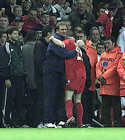 Fotball: Liverpool's care-taker manager embraces young goalscorer Stephen Wright after beating Borussia Dortmund 2-0 in the UEFA Champions League Group B match at Anfield.