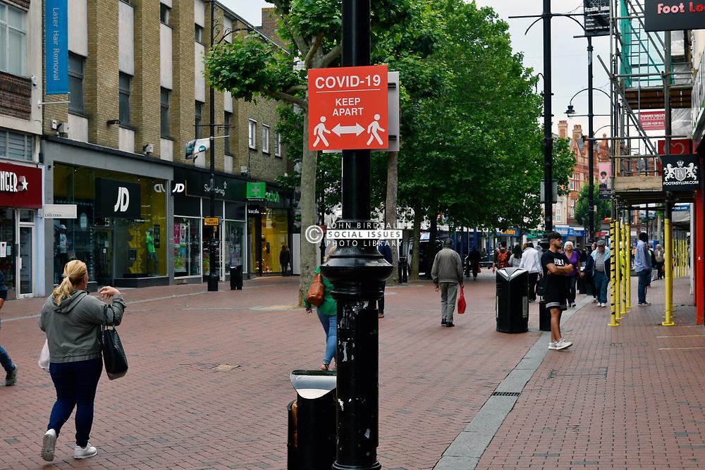 Covid-19 sign in Broad Street. Easing of Coronavirus lockdown, Reading, UK 12 June 2020