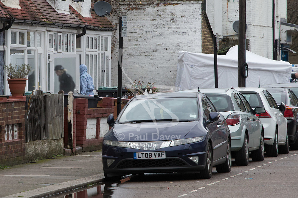 A forensics investigator enters a home at the scene in Chalgrove Road, Tottenham, North London, where a seventeen year-old girl was shot dead on the evening of April 2nd. London, April 03 2018.
