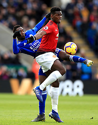 Leicester City's Wilfred Ndidi (left) and Manchester United's Paul Pogba battle for the ball during the Premier League match at the King Power Stadium, Leicester.