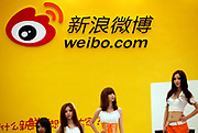 Models pose at the Sina Weibo booth at the ChinaJoy Expo, also know as the China Digital Entertainment Expo and Conference,  in Shanghai, China on 29 July, 2011. With over 100 million subscribers, Weibo, China's own twitter-like micro blog social network service from Sina.com has become a rare platform for Chinese netizens to voice their discontent  as well as exposing corruption. So much so that the central government has recently required all users to register with their real names in hopes of increasing its censorship.