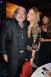 ROBERT TCHENGUIZ and GINTA BIKU at the Caudwell Children's annual Butterfly Ball held at The Grosvenor House Hotel, Park Lane, London on 15th May 2014.