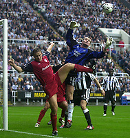 Photo. Glyn Thomas<br />Newcastle United v Bolton Wanderers. <br />Barclaycard Premiership.<br />St James' Park, Newcastle. 20/09/2003.<br />Newcastle keeper Shay Given (R) punches away an attempt from Kevin Davies.
