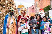 Three Kings pose with children and their gifts during El Dia de Reyes in the historic Jardin January 6, 2016 in San Miguel de Allende, Mexico. The traditional festival marks the culmination of the twelve days of Christmas and commemorates the three wise men who traveled from afar, bearing gifts for the infant baby Jesus.