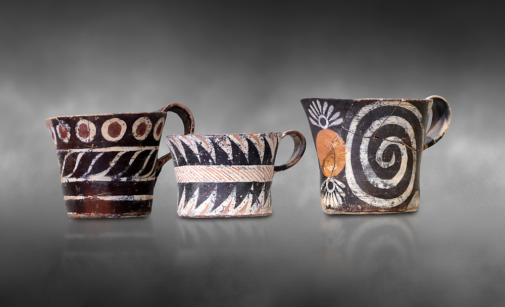 """Minoan Kamares """"eggshell"""" ware cups with  with  polychrome decorations, from set found at Phaistos Palace 1800-1600 BC; Heraklion Archaeological  Museum, grey background.<br /> <br /> These cups found as parts of sets in Phaistos palace were names """"eggshell"""" ware due to the very thin walls of the cups. This style of pottery is named afetr Kamares cave where this style of pottery was first found .<br /> <br /> If you prefer to buy from our ALAMY PHOTO LIBRARY  Collection visit : https://www.alamy.com/portfolio/paul-williams-funkystock/minoan-art-artefacts.html . Type -   Heraklion   - into the LOWER SEARCH WITHIN GALLERY box. Refine search by adding background colour, place, museum etc<br /> <br /> Visit our MINOAN ART PHOTO COLLECTIONS for more photos to download  as wall art prints https://funkystock.photoshelter.com/gallery-collection/Ancient-Minoans-Art-Artefacts-Antiquities-Historic-Places-Pictures-Images-of/C0000ricT2SU_M9w"""