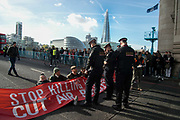 Action by Stop Killing Londoners, Cut Air Pollution campaign on 30th October 2017 in central London, England, United Kingdom. The campaign aims to draw attention to the poor air quality of London and the effect of this on peoples health. For one hour seven activists sat in the road on Tower Bridge, London, stopping traffic. Seven people were arrested.