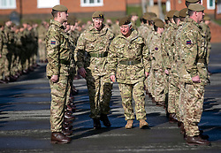 The Prince of Wales, Colonel Welsh Guards (centre right), attends Elizabeth Barracks in Woking to present campaign medals to soldiers from the 1st Battalion Welsh Guards following their return from Afghanistan.