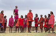 Maasai people preforming the traditional jumping dance in a Maasai village in Maasai Mara, Kenya.