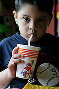 (MODEL RELEASED IMAGE). At home in San Antonio, Texas, 5-year-old Brian Fernandez polishes off a soda from the fast-food chain, Whataburger. (Supporting image from the project Hungry Planet: What the World Eats.)