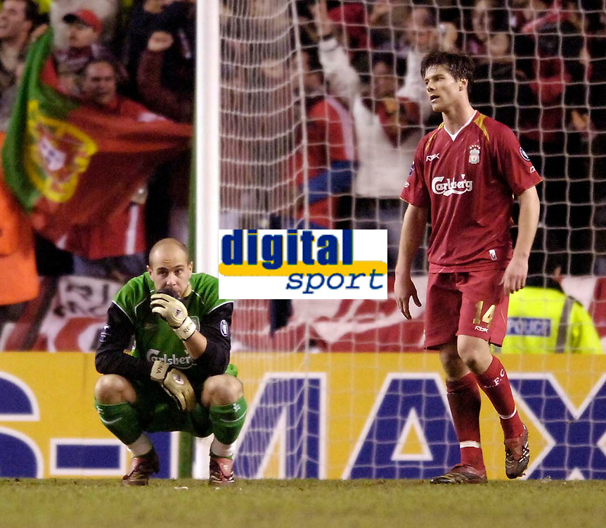 Photo: Jed Wee.<br /> Liverpool v Benfica. UEFA Champions League. 08/03/2006.<br /> <br /> Liverpool's Jose Reina (L) and Xabi Alonso feel the pain of defeat.