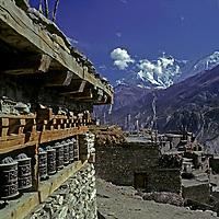 NEPAL, HIMALAYA, Tibetan Buddhist prayer wheels in Manang (Annapurna region).