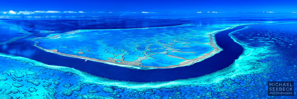 An aerial panoramic photograph of a spectacular reef channel and coral reefs in the Great Barrier Reef.<br /> <br /> Limited Edition of 125 prints
