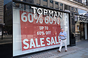 Closed down Topman retail clothing store on 11th August 2021 in London, United Kingdom. Topman was a UK-based multinational mens fashion store chain founded by Burton in 1970. Along with its womens clothing counterpart Topshop, Topman was a subsidiary of the Arcadia Group when it went into administration in late 2020. The brand was purchased by ASOS on 1 February 2021 to operate online only.