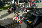 Primary schoolchildren and parents at the end of the day in West London, during the second wave of the Coronavirus pandemic, on 20th October 2020, in London, England.