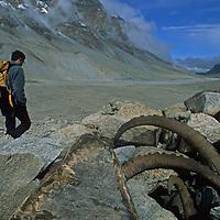 Trekker Jeremy Schmidt walks past Ibex horns left in a cairn in the Pamir Mountains near Lake Karakul in Xinjiang Province of far-western China.