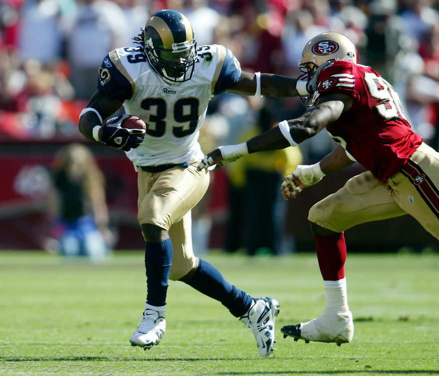 St. Louis Rams running back Steven Jackson (39) tries to stiff arm San Francisco 49ers linebacker Andre Carter during the fourth quarter of an NFL football game, Sunday, Sept. 11, 2005 at Candlestick Park in San Francisco. The 49ers won their regular season opener, 28-25. (D. Ross Cameron/the Oakland Tribune)