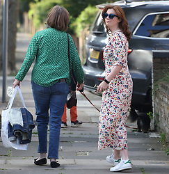© Licensed to London News Pictures. 26/06/2021. London, UK. Martha Hancock, wife of Health Secretary Matt Hancock leaves home. It is being reported that the health secretary has been in a relationship with an aide. Photo credit: Ben Cawthra/LNP