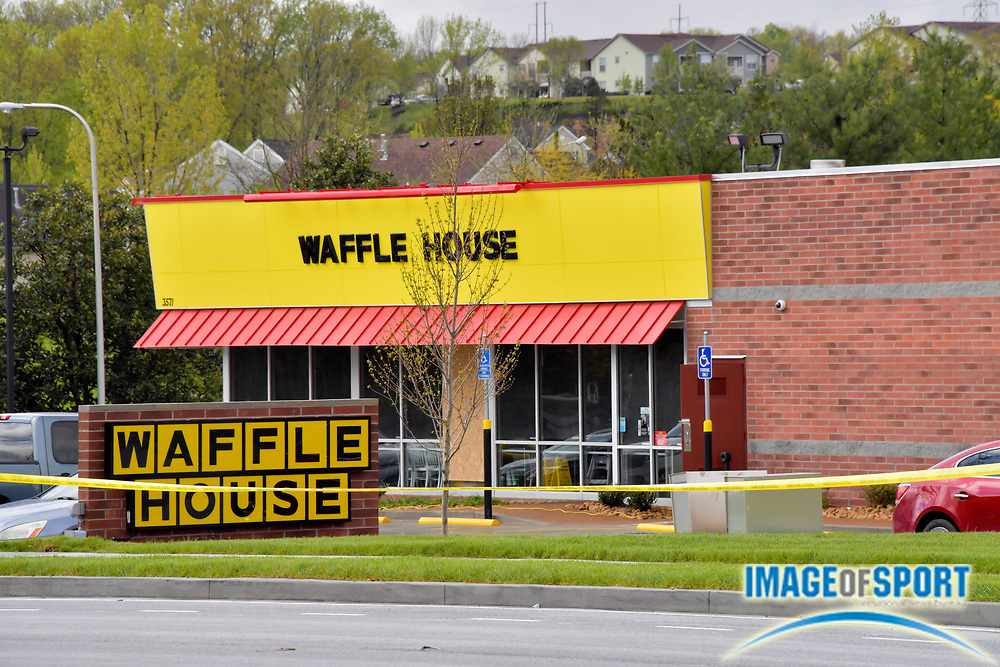 Police tape continues to surround the Waffle House on Murfreesboro Road on Monday, April 23, 2018 in Nashville, Tenn. after a shooting on Sunday morning. Travis Reinking is the suspect in the shooting at the Waffle House restaurant Sunday in Nashville that resulted in the death of four people. Reinking is now in the custody of the Metro Nashville Police following a search lasting over 24 hours. (Jim Brown\IOS via AP)