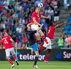 26.05.2012, Ullevaal Stadion, Oslo, NOR, UEFA EURO 2012, Testspiel, Norwegen vs England, im Bild England's Andy Carroll (Liverpool) in action against Norway's captain Brede Hangeland (Fulham) and Alexander Tettey (Rennes) during the Preparation Game for the UEFA Euro 2012 betweeen Norway and England at the Ullevaal Stadium, Oslo, Norway on 2012/05/26. EXPA Pictures © 2012, PhotoCredit: EXPA/ Propagandaphoto/ Vegard Grott..***** ATTENTION - OUT OF ENG, GBR, UK *****