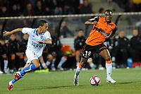FOOTBALL - FRENCH CHAMPIONSHIP 2011/2012 - L1 - FC LORIENT v AJ AUXERRE - 21/09/2011 - PHOTO PASCAL ALLEE / DPPI - GILLES SUNU (FCL) / KARIM CHAFNI (AJA)