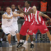 Anadolu Efes's Sinan GULER (L) and Olympiacos's Kalin LUCAS (C) during their Two Nations Cup basketball match Anadolu Efes between Olympiacos at Abdi Ipekci Arena in Istanbul Turkey on Sunday 02 October 2011. Photo by TURKPIX