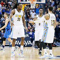 06 March 2016: Denver Nuggets guard D.J. Augustin (12) is congratulated by Denver Nuggets forward Kenneth Faried (35) and Denver Nuggets guard Emmanuel Mudiay (0) during the Denver Nuggets 116-114 overtime victory over the Dallas Mavericks, at the Pepsi Center, Denver, Colorado, USA.
