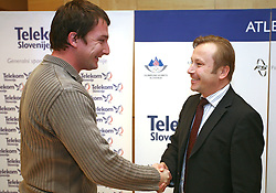 Primoz Kozmus and president of AZS dr. Peter Kukovica when Athletic Federation of Slovenia (AZS) and top Slovenian athletes sign a contract of sponsorship, on February 14, 2008 in M-Hotel, Ljubljana, Slovenia. (Photo by Vid Ponikvar / Sportal Images)