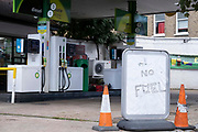 As the fuel transport crisis continues into its second week, sealed BP petrol and diesel pumps are covered in a closed petrol and fuel station in south London, on 27th September 2021, in London, England. The shortages at retailers around the country are caused by the UKs lack of qualified HGV Heavy Goods Vehicles drivers who deliver supplies to the nations fuel forecourts, the majority of which are now closed after panic-buying drained fuel stock.