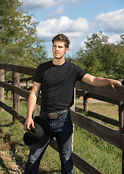 handsome All American cowboy on a ranch