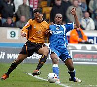 Photo: Ed Godden.<br />Wolverhampton Wanderers v Cardiff City. Coca Cola Championship. 11/03/2006. <br />Joleon Lescott (L) and Cardiff's Cameron Jerome clash together.