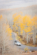 Car driving through the forests surrounding Park City in Fall, Autumn, Utah, United States of America