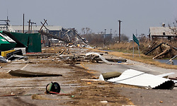 26 Sept, 2005. Cameron, Louisiana. Hurricane Rita aftermath. <br /> The destroyed remains of  downtown business in Cameron, Louisiana two days after the storm ravaged the small town. The main road into town is littered with power lines and debris.<br /> Photo; ©Charlie Varley/varleypix.com