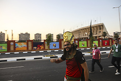 July 10, 2019 - Cairo, Egypt - Egyptian guy with cap of Pharaon outside of International Stadium of Cairo before the match Nigeria-South Africa. Nigeria win the match for 2 at 1. Despite the defeat of Egypt are many fans come to stadium for the match. In the International Stadium of Cairo, Egypt on 10 July 2019.  (Credit Image: RealTime Images)