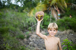 Boy with fresh picked coconut, Mauritius