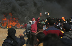 April 27, 2018 - Gaza, gaza strip, Palestine - Palestinian demonstrators remove the Israeli barbed wire during clashes with Israeli troops at a protest demanding the right to return to their homeland, at the Israel-Gaza border, east of Gaza City, April 27, 2018. (Credit Image: © Majdi Fathi/NurPhoto via ZUMA Press)