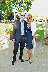 VISCOUNT & VISCOUNTESS COWDRAY at the Frost Family Summer party in support of the British Heart Foundation and the Mile Frost Fund held at Burton Court, Chelsea, London  on 18th July 2016.