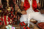 Israel The Hina, also Henna ceremony proceeds the wedding day. In this festive ceremony, natural red dye is applied on the hands of the participants especially the bride and groom, to symbolize happiness, wealth and a successful union of the young couple.