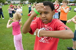 Young Teenager taking part in a Superhero workout at a Parklife summer activities event,