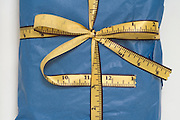 gift wrapped with a tape measure like ribbon