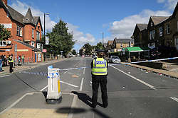 © Licensed to London News Pictures. 29/08/2016. Leeds, UK. Police at what is believed to be the scene of shooting that took place last night. This is as yet unconfirmed by the police. The incident happened in the Chappeltown area of Leeds where the West Indian Carnival is taking place this weekend. Photo credit : Ian Hinchliffe/LNP