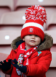 A young Middlesbrough fan with wooly hat in the stand