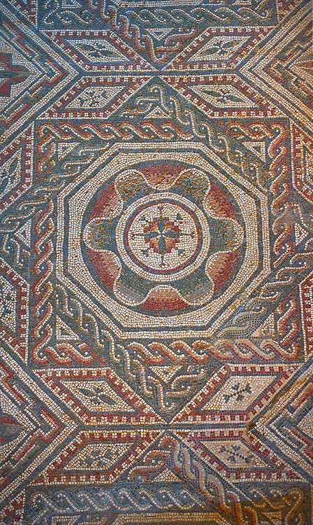 Close up picture of the Roman mosaics of the Room with Star Shaped Decorations depicting an octagonal rosette geometric mosaic patterns, room no 22 at the Villa Romana del Casale, first quarter of the 4th century AD. Sicily, Italy. A UNESCO World Heritage Site. .<br /> <br /> If you prefer to buy from our ALAMY PHOTO LIBRARY  Collection visit : https://www.alamy.com/portfolio/paul-williams-funkystock/villaromanadelcasale.html<br /> Visit our ROMAN MOSAICS  PHOTO COLLECTIONS for more photos to buy as buy as wall art prints https://funkystock.photoshelter.com/gallery/Roman-Mosaics-Roman-Mosaic-Pictures-Photos-and-Images-Fotos/G00008dLtP71H_yc/C0000q_tZnliJD08