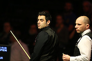 Ronnie O'Sullivan in action during his semi final match against Joe Perry (r). Betvictor Welsh Open snooker 2016, day 6 Semi finals day at the Motorpoint Arena in Cardiff, South Wales on Saturday 20th Feb 2016.  <br /> pic by Andrew Orchard, Andrew Orchard sports photography.